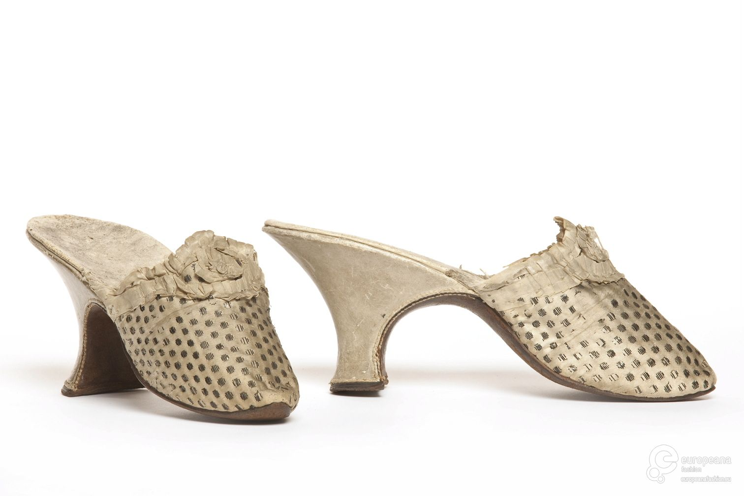 Pair of lady's mules, 1770-1780. Cream silk satin embroidered with dots in silver metallic thread, leather.