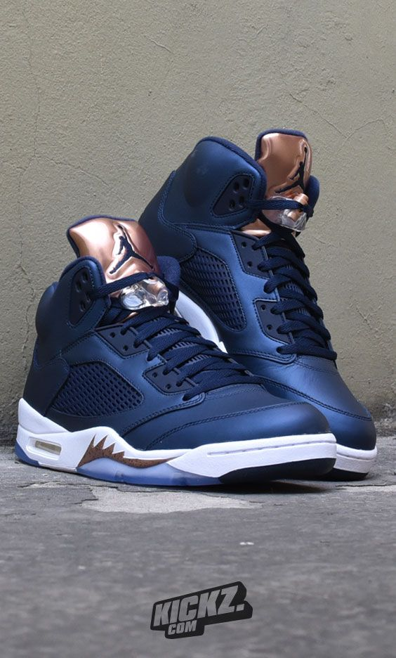 detailed look 80dd3 3b95f The legendary Air Jordan 5 Retro never shined so bright like in the   Obsidian  colorway with the bronze tongue.