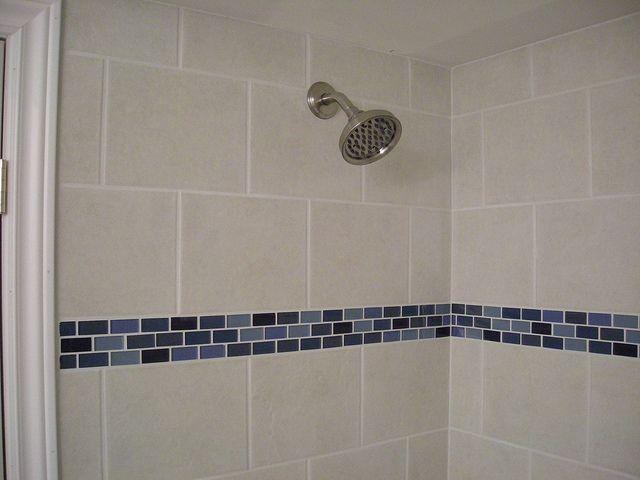 Ceramic tile shower stall with glass border detail Tile
