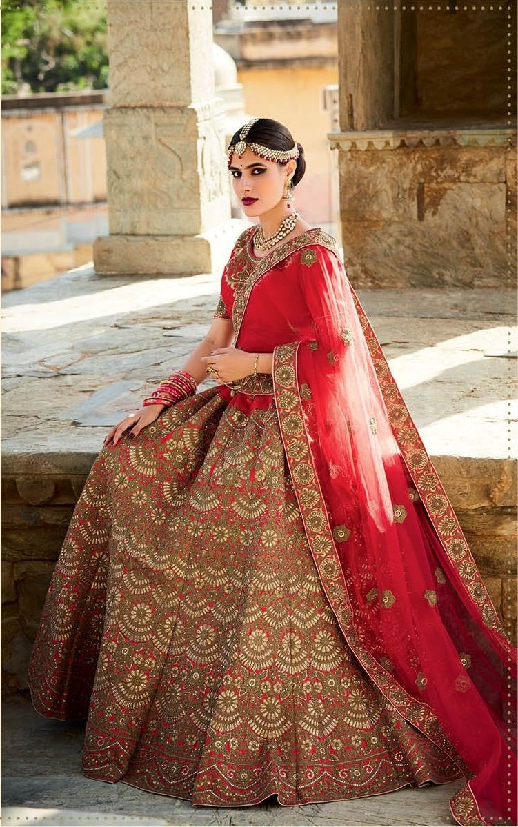 Price @14249.00 INRColour : Red  Top Material : Mastani Silk  Lehenga Material : Art Silk  Dupatta Material : Net  Work : Heavy Embroidery With Handwork