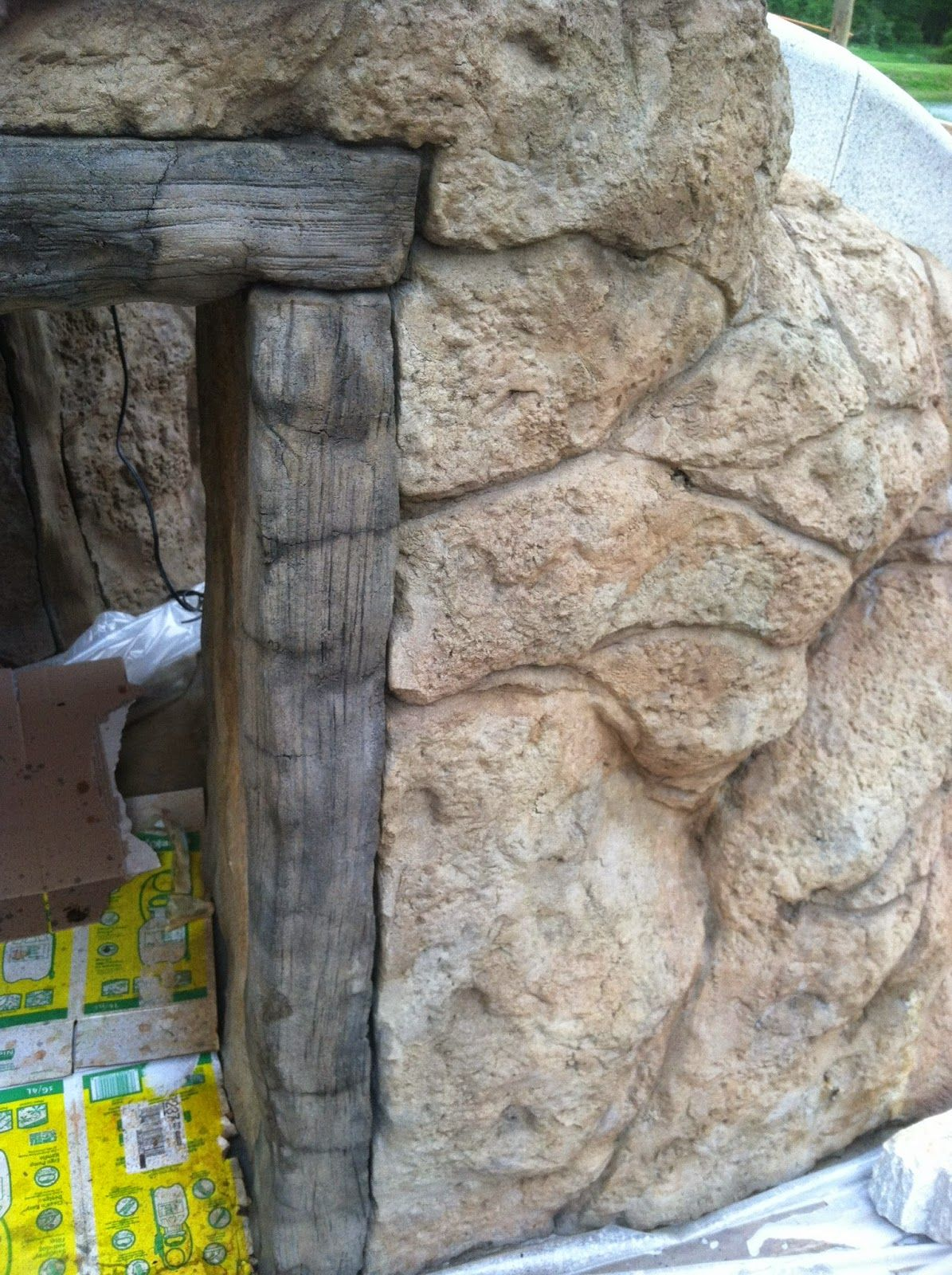 Vertical Carved Concrete pool surround | Faux stone walls ...