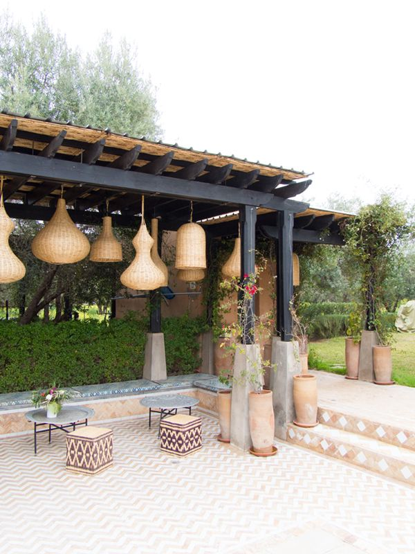 love the clusters of basket lights in this patio   peacock pavilions in marrakech via coco+kelley