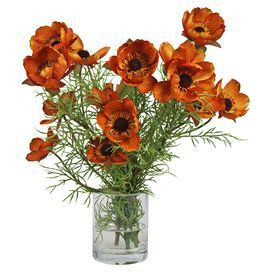 """Silk orange poppies in a vase with faux water.    Product: Faux floral arrangementConstruction Material: Silk, plastic, acrylic and glassColor: Orange, brown and greenDimensions: 18.5"""" H x 18"""" DiameterCleaning and Care: For indoor use only"""