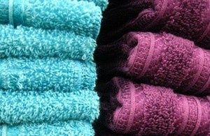 Use baking soda and vinegar to fix funky towels. Over time, and with many washes, your bath towels will build up detergent and fabric softener residue, leaving them both unable to absorb as much water and smelling kinda funky when they do. Rather than give Target another lump sum, run them through the wash once with hot water and a cup of vinegar, then again with hot water and a half-cup of baking soda. @Donald Hart