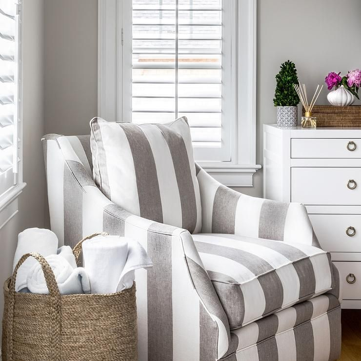 Gray And White Bedroom Is Furnished With A Gray Striped Accent