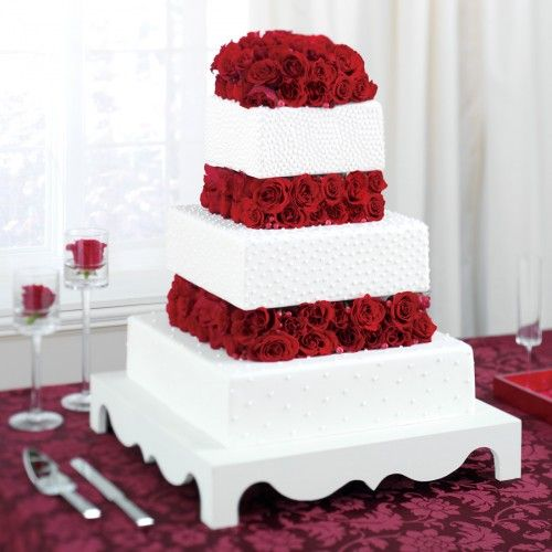Beautiful red flowers and white cake Wishing for the Wedding of
