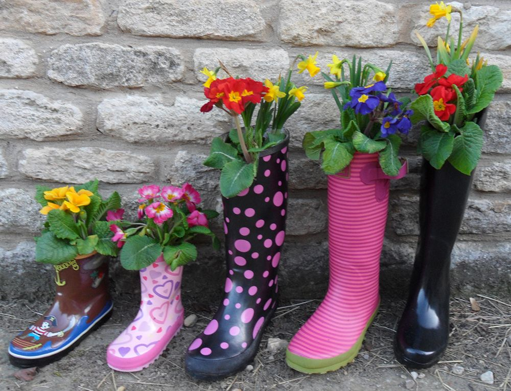 fc2ee5c7bf7 Use your old wellies as welly planters in the garden!