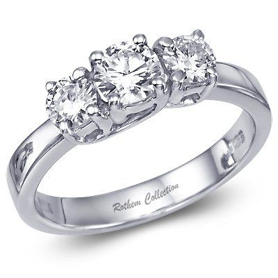 Classic white gold three stone diamond engagement ring featuring