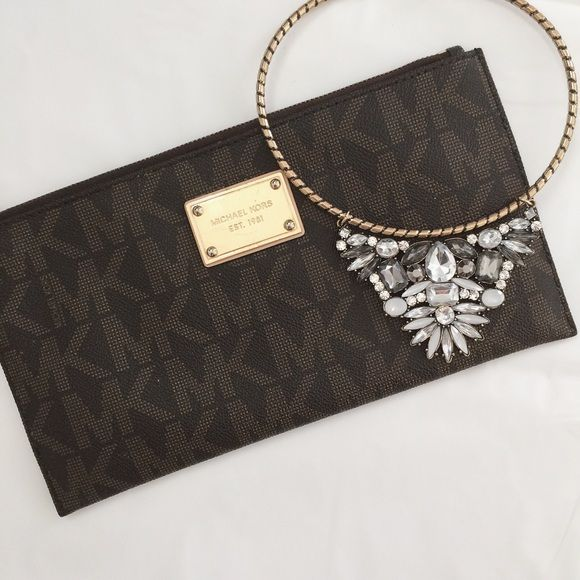 Michael Kors Wristlet Authentic brown Michael Kors PVC leather wristlet/wallet // features many pockets inside for cards and cash // gold hardware is scratched as seen in pictures // open to reasonable offers ✖️I DO NOT TRADE✖️ MICHAEL Michael Kors Bags Clutches & Wristlets
