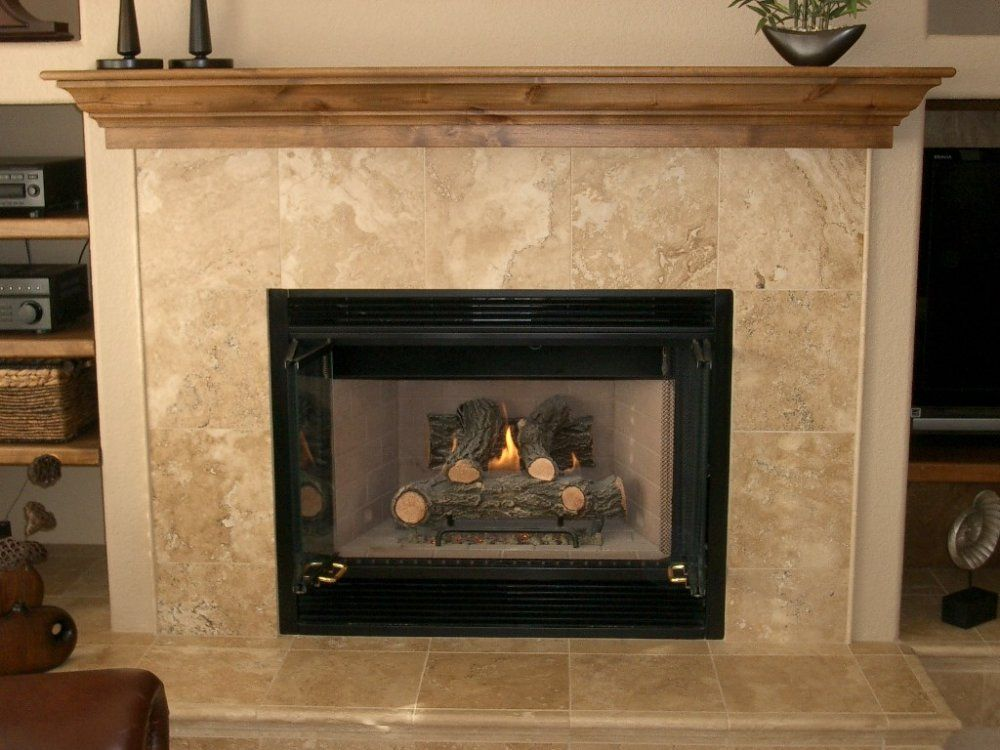 Under Tv Fireplace With Travertine Surround Design Is Good Position