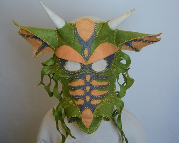 Transform in to a mighty dragon. Guard piles of treasure, dine on tasty princesses, breathe fire, and soar high over forests. A felt mask with hand