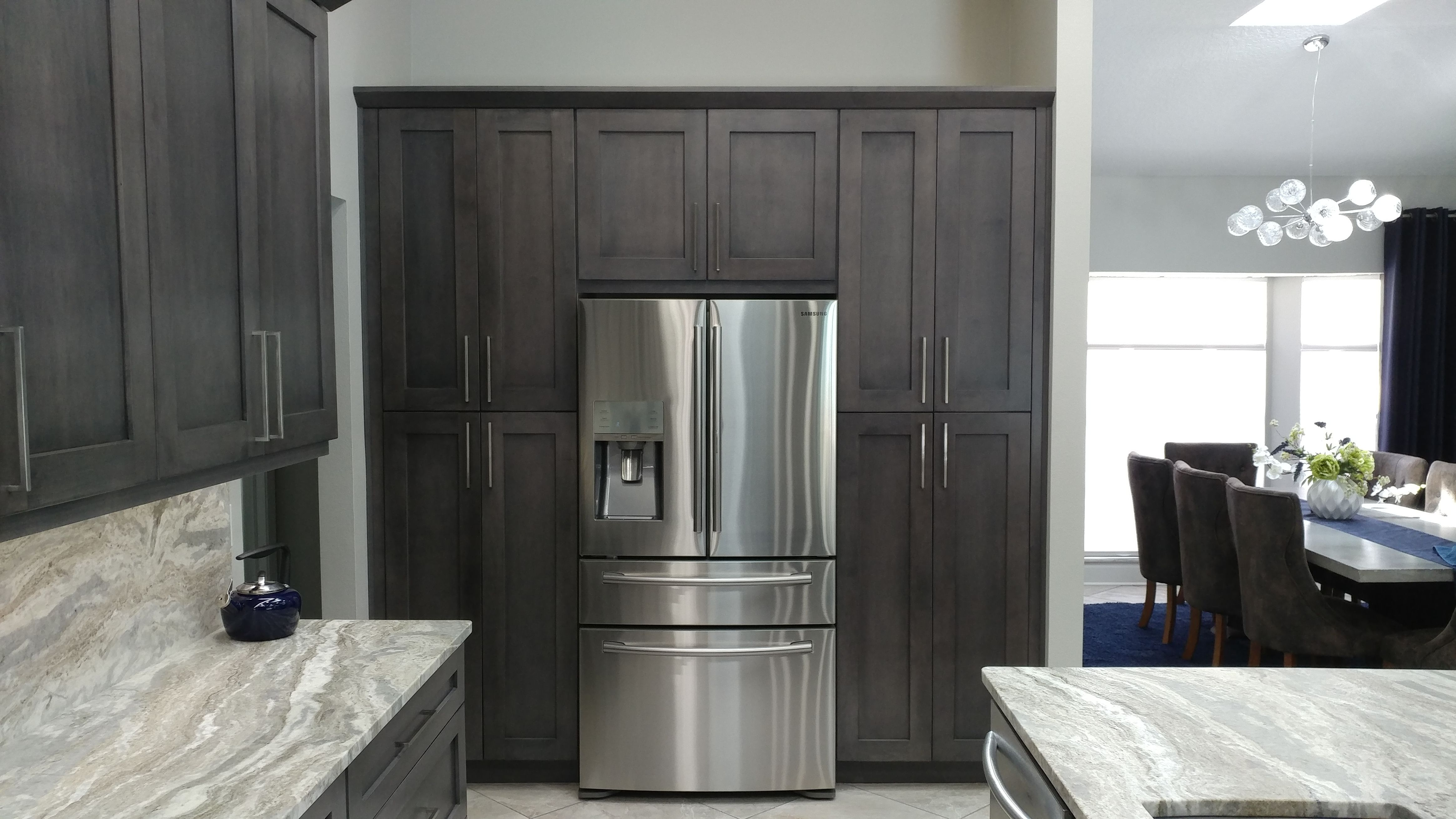 The Soothing Pallet Of Slate Shaker Cabinets By Eudora And Fantasy Brown Quartzite With A Leather Finish Make This Home A Built In Pantry Slate Kitchen Cabinet