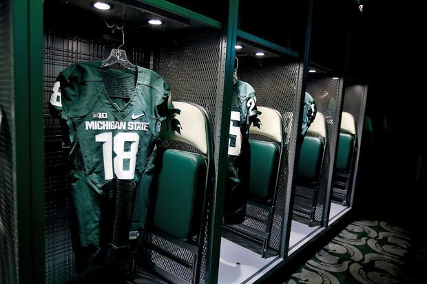 Connor Cook S And Other Key Players Uniforms Hang In Lockers During A Tour Of Michigan State Football S New Lo Michigan State Football Michigan State Michigan