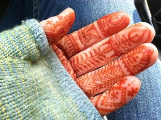 Moroccan henna style -Alchemy Henna.  So cute peeking out of the fingerless gloves!