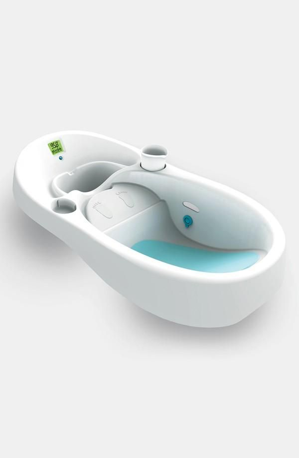 Infant tub allows clean water to flow in while dirty water flows out ...