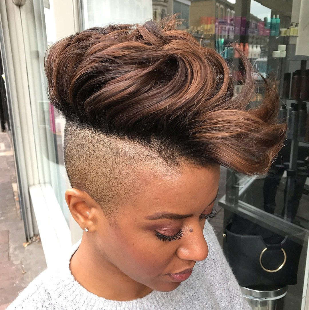 Bold long top shaved sides hairstyle for women