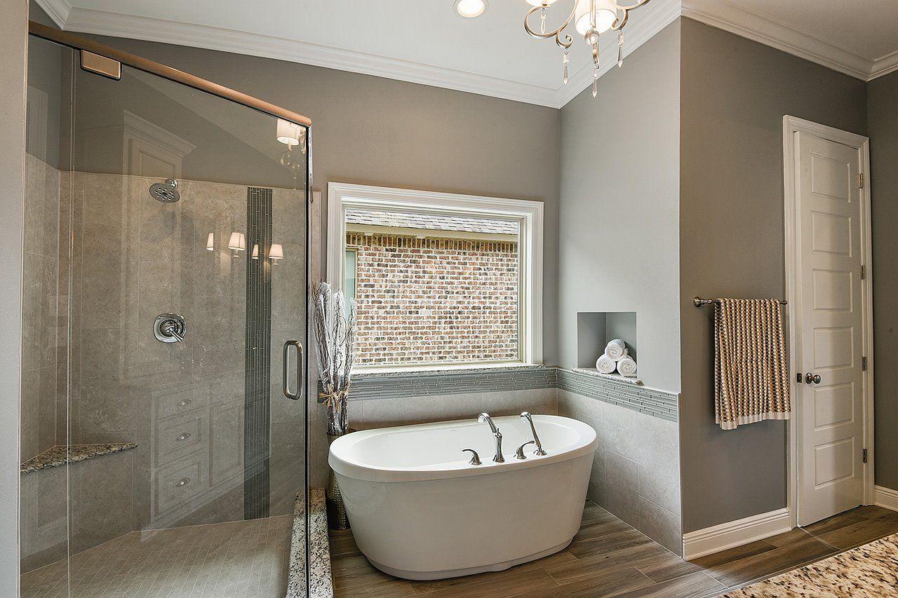elegant master bathroom with a free standing tub  free