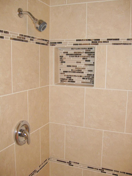 Shower Tile Installation Using 12x12 Porcelain With A Linear Glass Tile Accent Band In Wesley Chapel Florida Shower Tile Linear Glass Tile Shower Niche