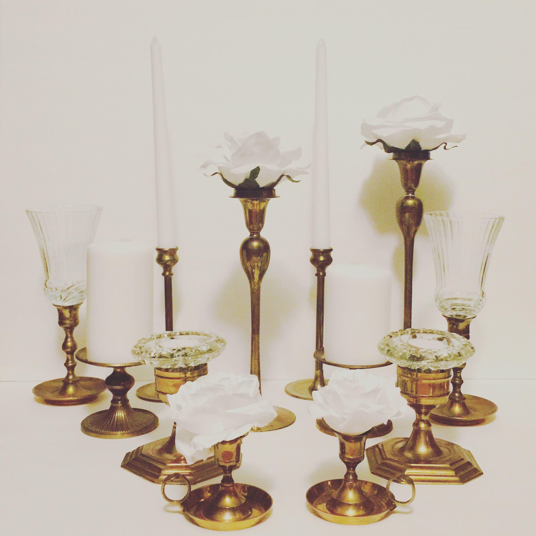Thin stemmed brass candlesticks. Perfect for an Art Deco themed ...