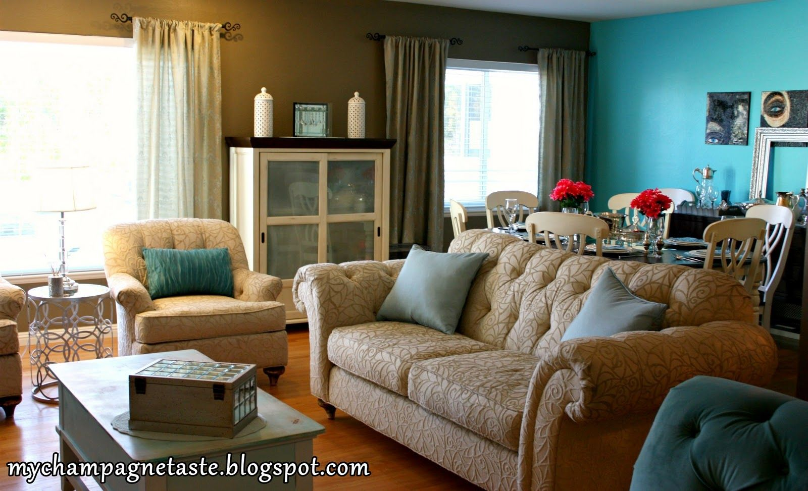 Champagne taste turquoise living and dining room i love her dining living room minus the hot pink flowers and weird eye paintings