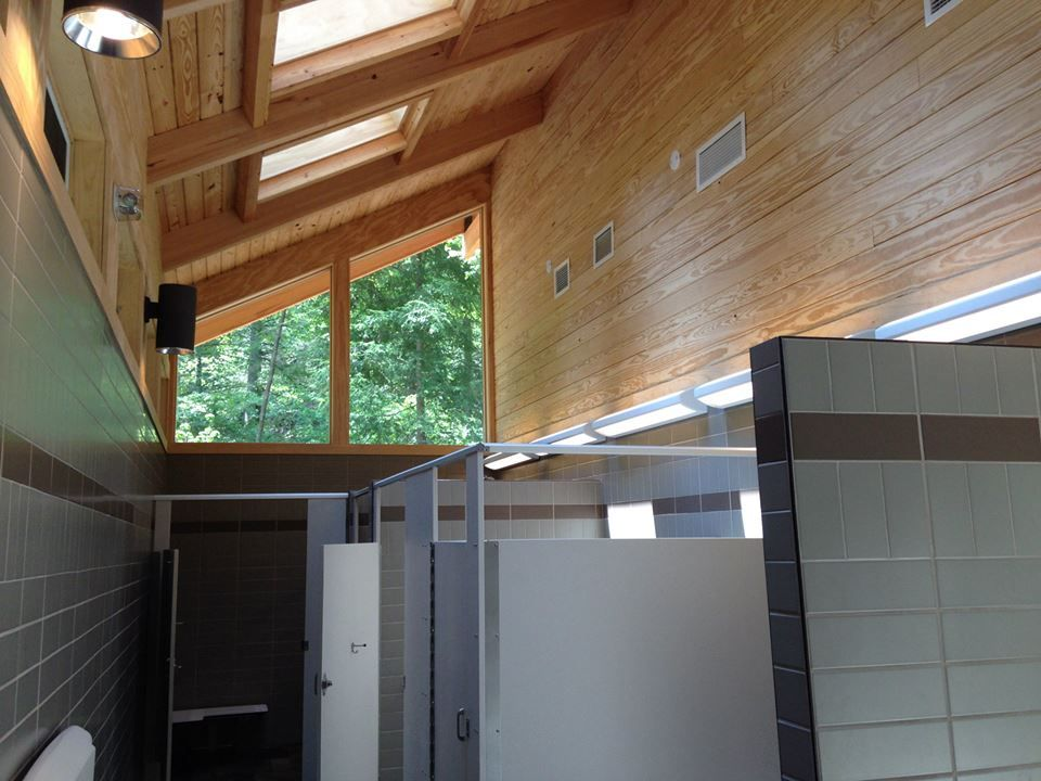 Inside view of the bath house  #bathhouse #showers # wood #archedceiling #camping #natural #lighting