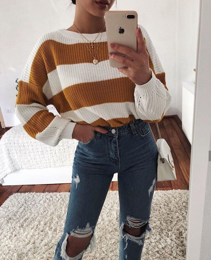 yellow and white striped sweater with ripped high waist jeans. Visit the daily outfit