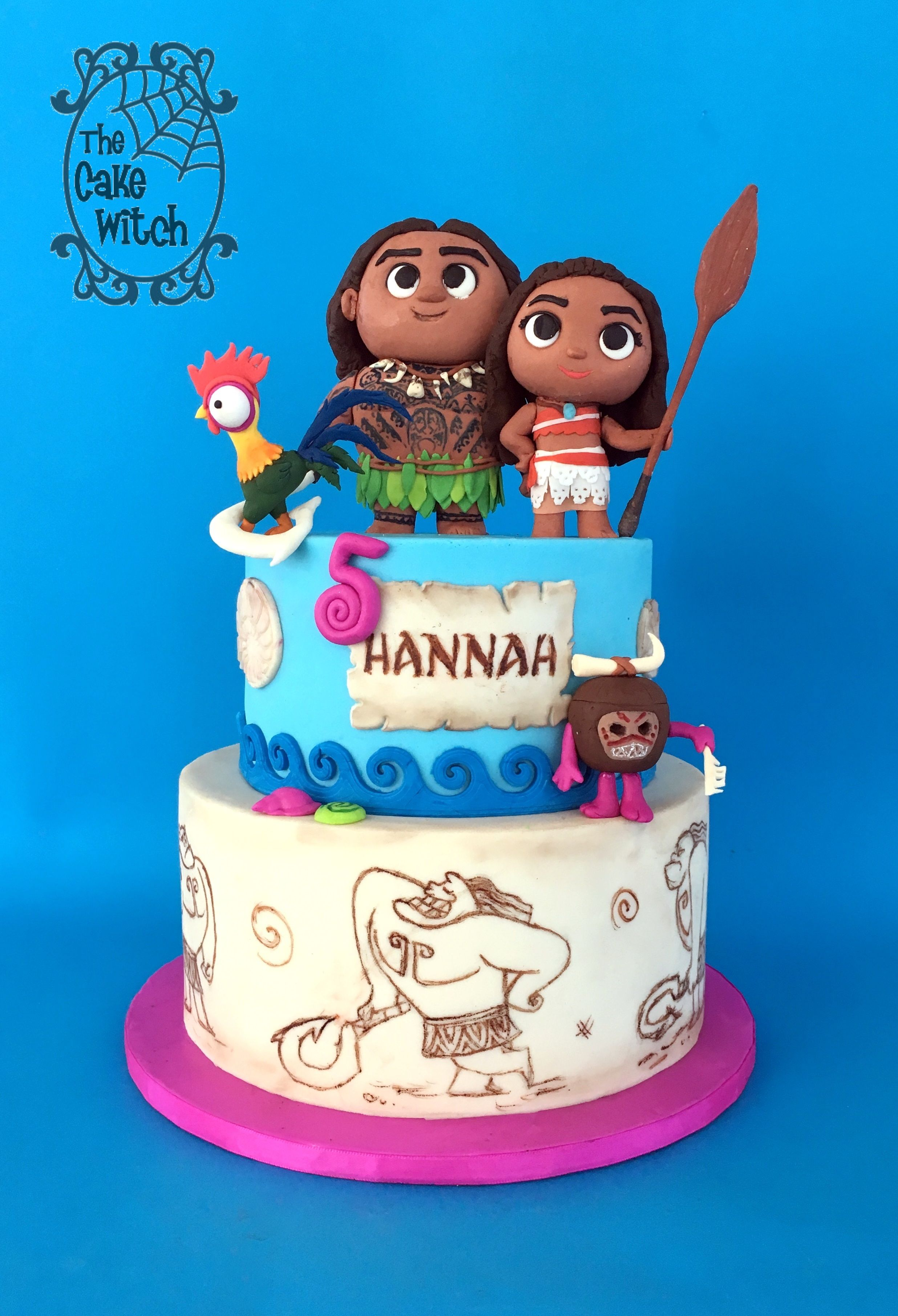 moana birthday cake with heyhey maui and kakamora figurines the