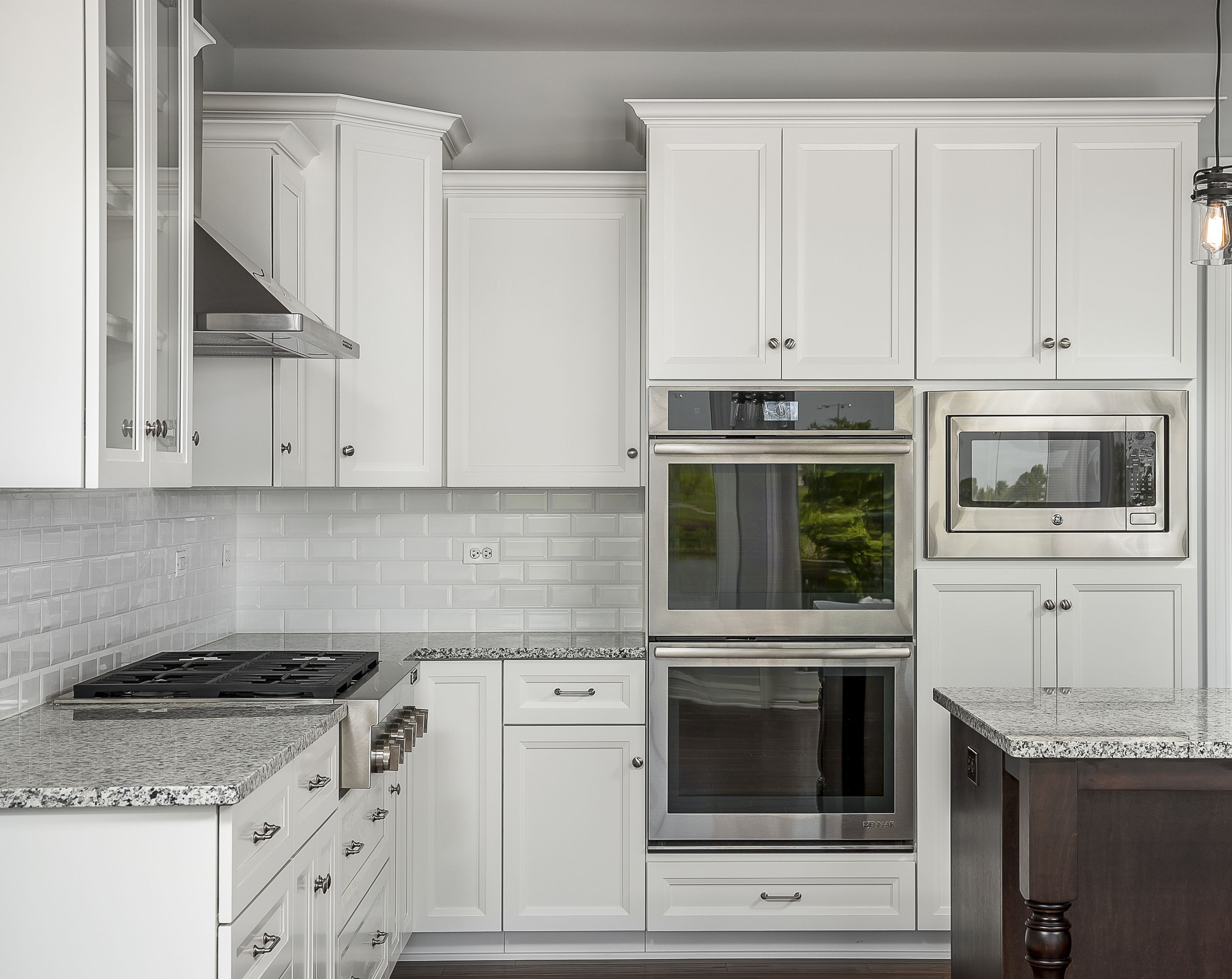 The Range Hood Double Oven Cooktop And White Cabinets Are Just A Few Of Our Favorite Things In Kitchen Remodel Small White Kitchen Remodeling Kitchen Remodel