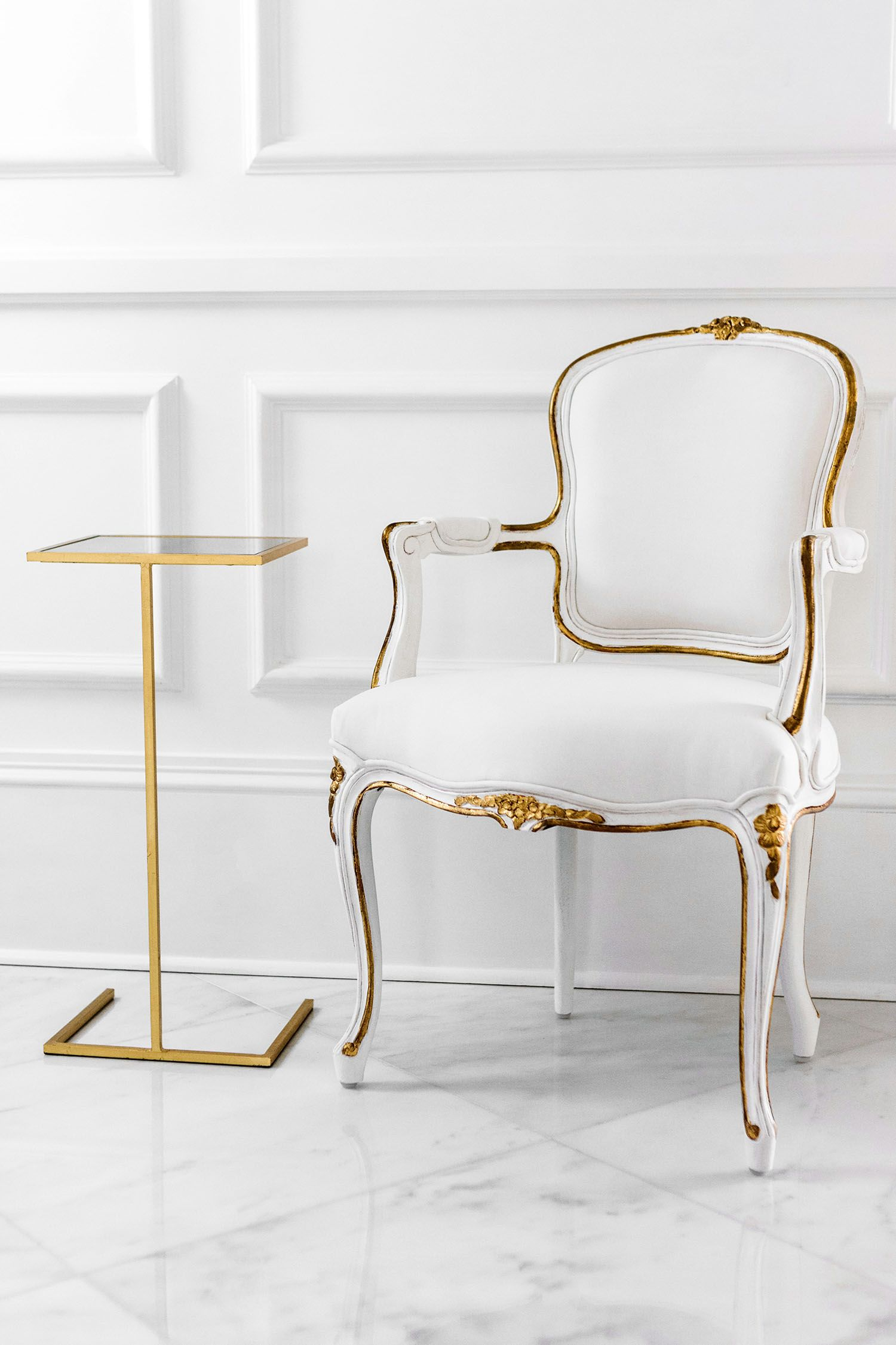 The Regent Side Chair from Ave Home   This hand crafted Louis XV style chair features delicate floral carvings, a hand applied white finish, gilded accents, and white upholstery.