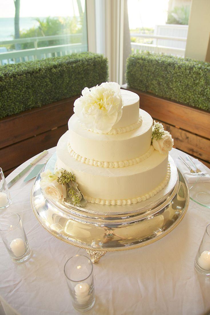 We created this beautiful custom wedding cake with three tiers. Top ...