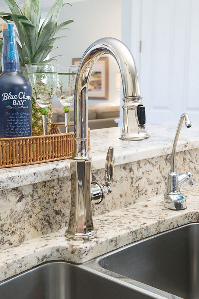 Granite countertop and polished nickel kitchen faucet ...