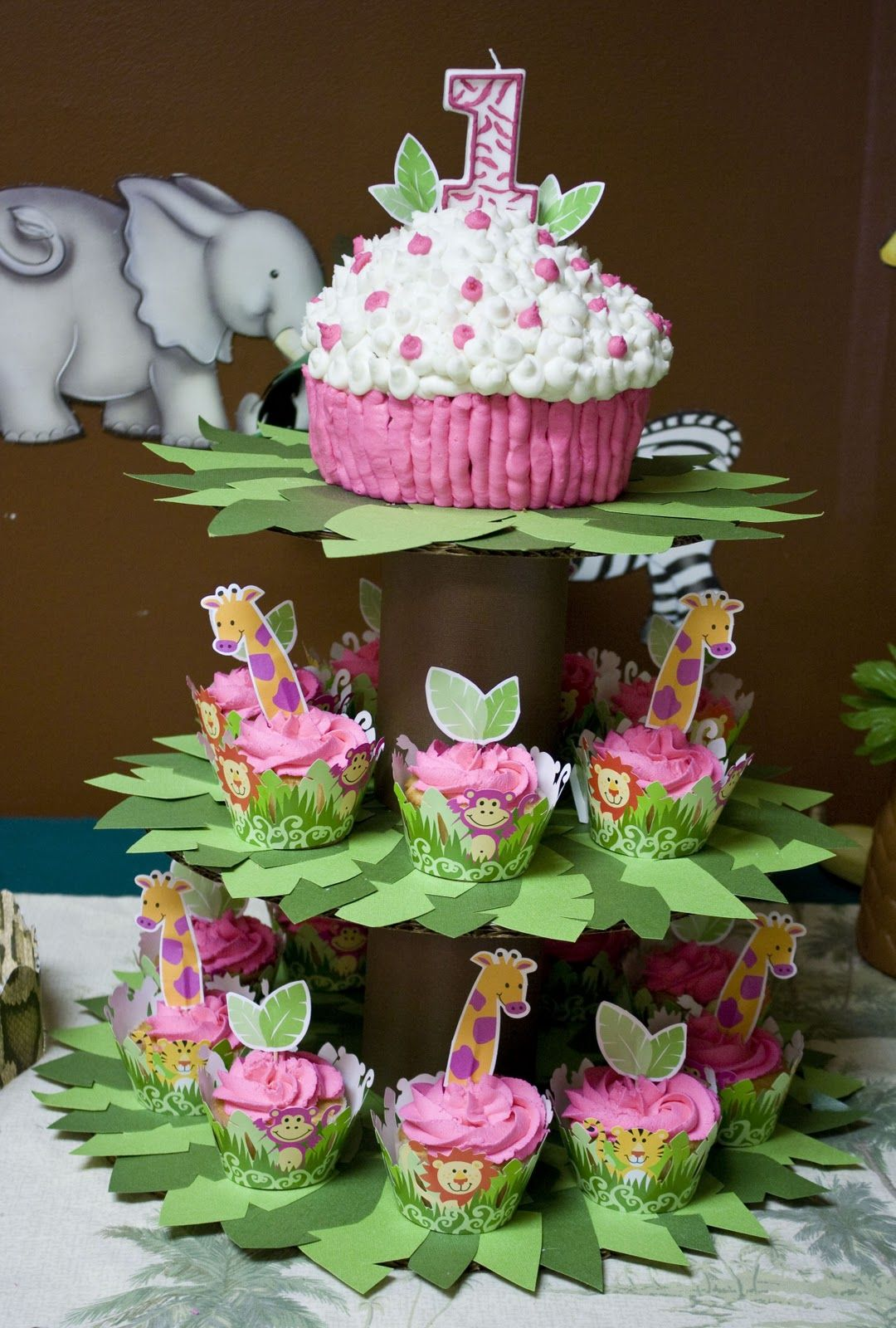 Zoo animal cupcakes tree stand baby girls first birthday Cakes