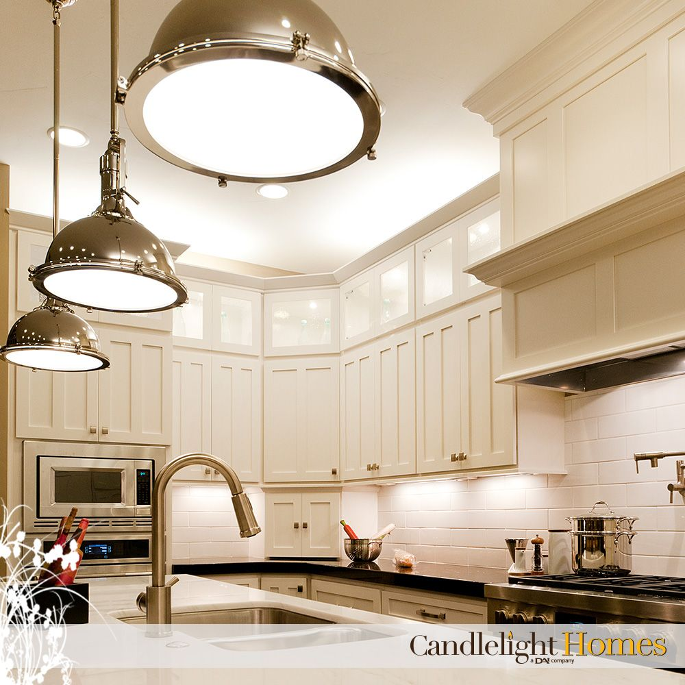 These polished chrome light fixtures make this kitchen shine ...
