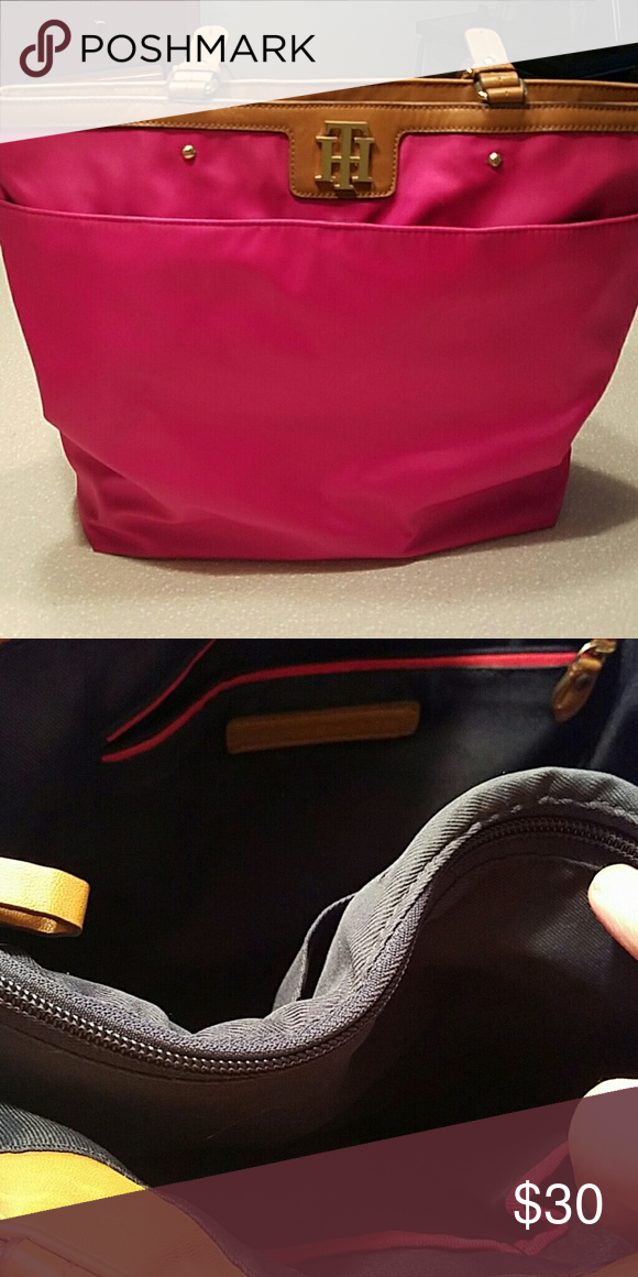 Tommy Hilfiger tote Pink zip tote. Small pen stain by the front snap and a little wear at the bottom. This is a canvas material. Roomy center zip inside Tommy Hilfiger Bags Totes