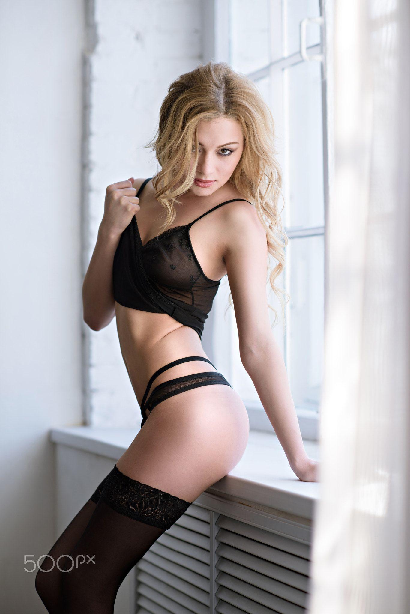 beautiful sexy lady in elegant black panties and stockings