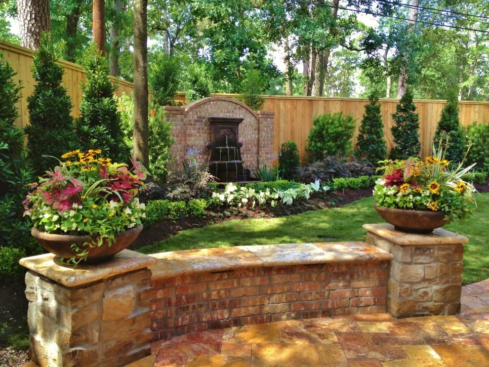 Enclosed Garden With Low Brick Wall Tuscan Landscaping Mediterranean Landscaping Mediterranean Garden Design