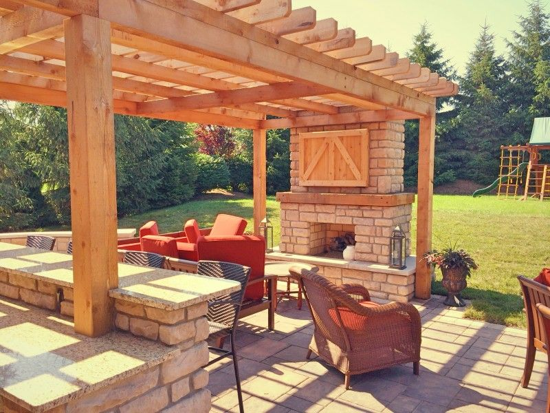 farmhouse style outdoor living space featuring custom cedar