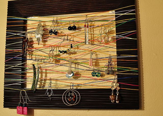 Earring Display made from a picture frame and embroidery floss :)