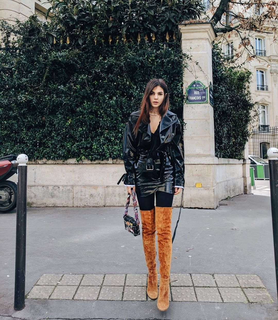girl wearing brown thigh high boots on