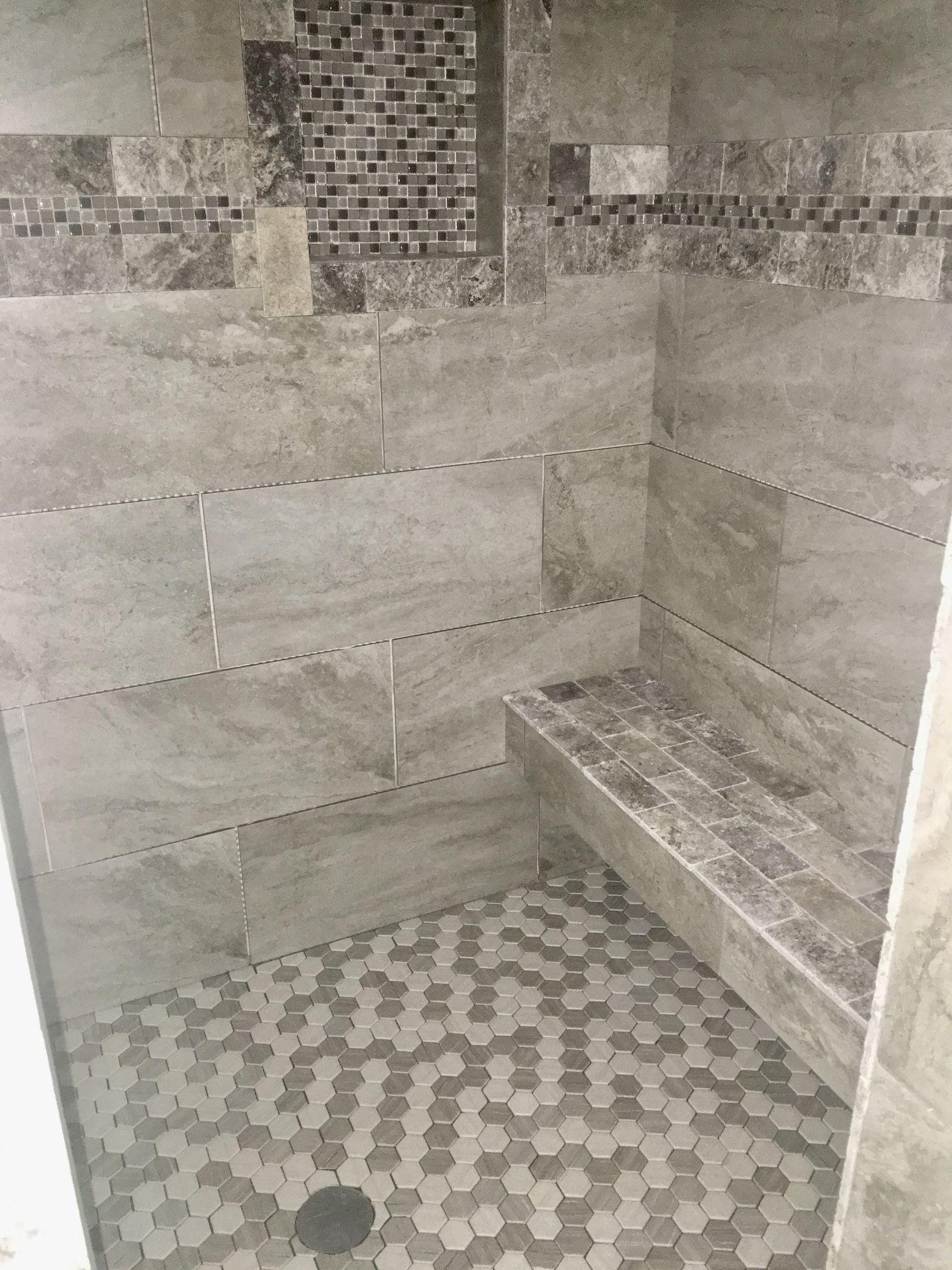 gray tile and travertine trim  beautiful tile bathroom