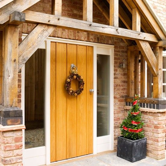 Step inside a new build home dressed for christmas front for Front door steps ideas