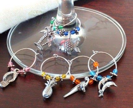 The most charming small wine gift. Coastal Wine Charms! Featured on CC: http://www.completely-coastal.com/2014/12/coastal-kitchen-gifts.html