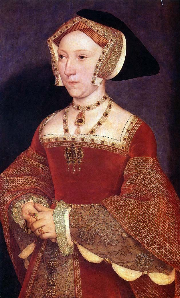 """Jane Seymour by Holbein, 1537   The famous red dress that supports the """"stomacher pinned over front lacing"""" theory (see the gold pins?). Note the undersleeve and underskirt fabrics. Also see the sleeve detail and the blackwork detail."""