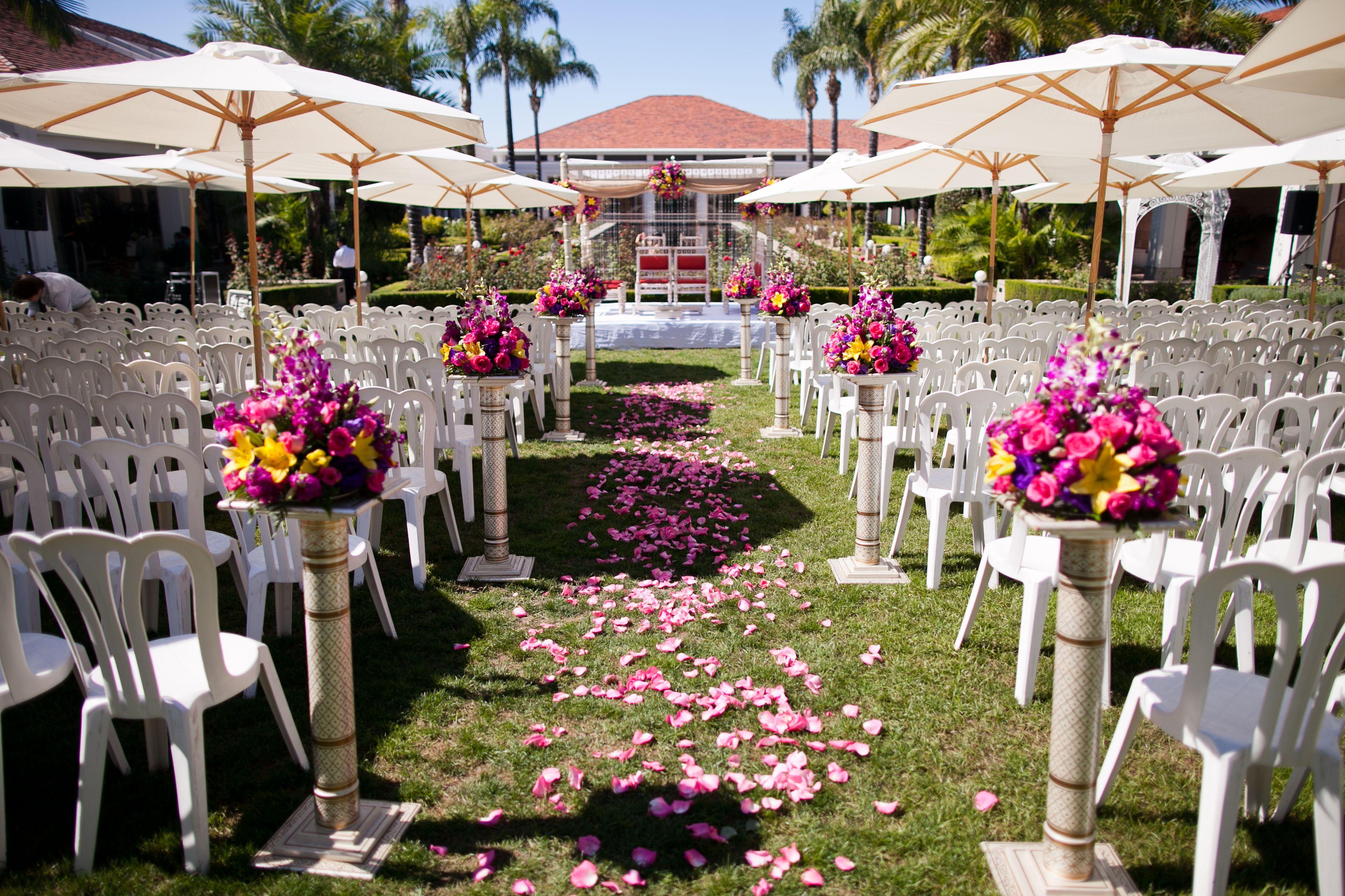 Rose petals leading the aisle to the mandap #nixonlibrary #wedding #weddingvenue #mandapideas  #indianceremony #socalwedding http://specialevents.nixonfoundation.org/weddings/
