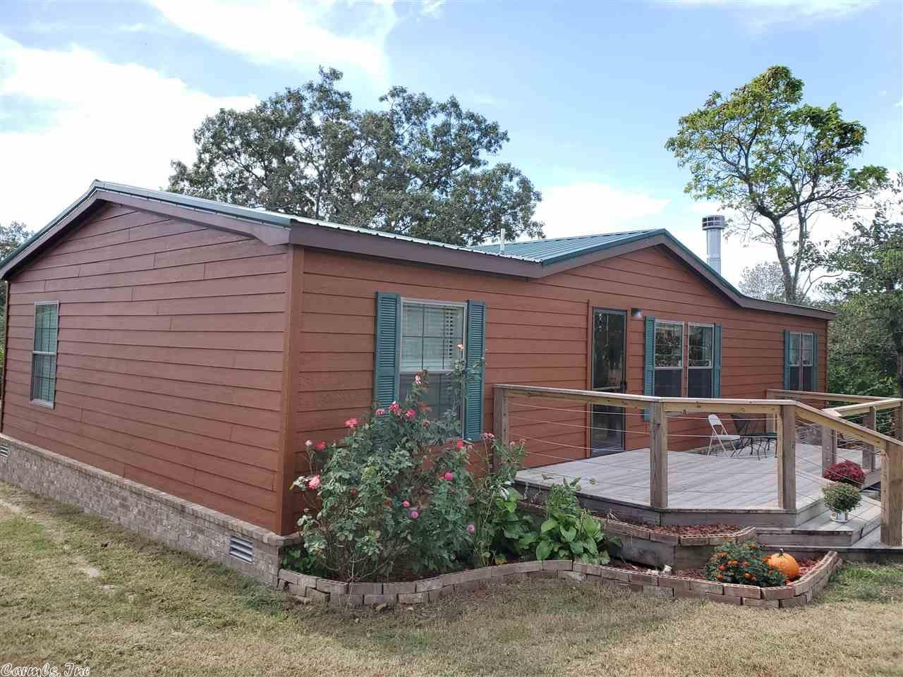 Immaculate maintained mobile home on 5 acres. Has 3 wells