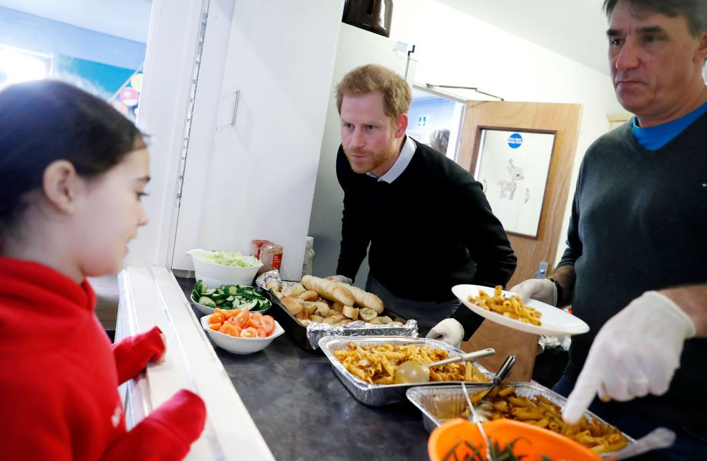 Prince Harry, Duke of Sussex serves a hot healthy lunch to