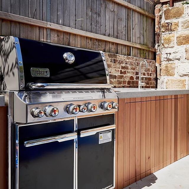 A Stunning Outdoor Kitchen Featuring The Weber Summit From