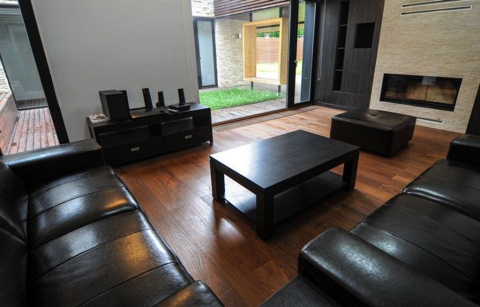 creative modern house in house design concept in timisoara romania comfortable black leather sofa furniture for modern living room design