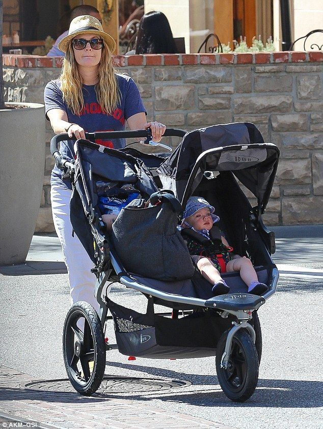 Drew Barrymore takes her youngest daughter for a stroll. (2015)