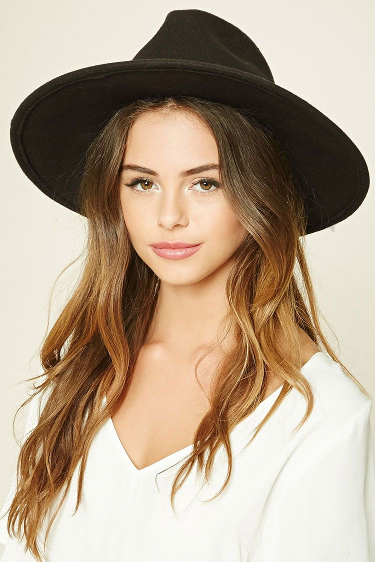 f7ebfbffc A wool wide-brim fedora featuring a faux leather band ...